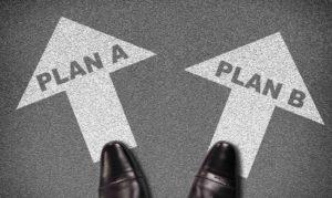 Schuhe zwei Pfeile mit Schriftzug Plan A und Plan B